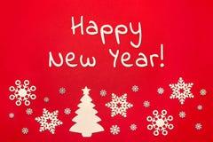 Arbre de flocons de neige et de Noël sur le fond rouge avec l'inscription Images stock