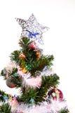 Arbre de Noël (artificiel) sur un fond blanc Photos stock