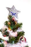 Arbre de Noël (artificiel) sur un fond blanc Photo stock