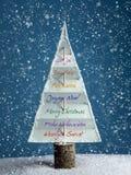 Arbre de Noël avec des salutations saisonnières Photographie stock libre de droits
