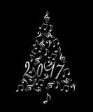 arbre 2017 de Noël avec les notes musicales en métal argenté Images stock