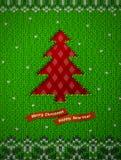 Arbre de Noël comme le trou à l'arrière-plan tricoté Photographie stock