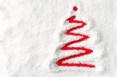 Arbre de Noël dans la neige Photos stock