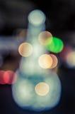 Arbre de Noël et éclairage de fête de bokeh Photographie stock