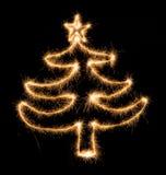 Arbre de Noël fait par le cierge magique sur un noir Photographie stock libre de droits