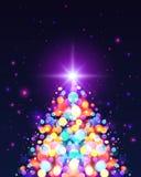 Arbre de Noël lumineux d'effet de la lumière de bokeh de couleurs Photos stock