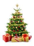 Arbre de Noël luxuriant avec des boîte-cadeau Photographie stock libre de droits