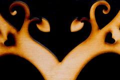 Arbre en bois décoratif abstrait sur le fond noir Image libre de droits