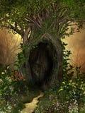 Arbre magique avec une caverne encadrée par des fleurs Image stock