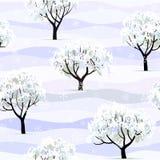 Arbres dans la neige dans le jardin d'hiver sans joint Photos libres de droits