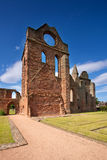 Arbroath Abbey, Angus, Scotland. Arbroath Abbey in Angus, Scotland is a red sandstone ruin founded in 1178 by King William the Lion and most famous as the place Stock Photography