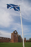 Arbroath Abbey and Saltire, Scotland Royalty Free Stock Photography