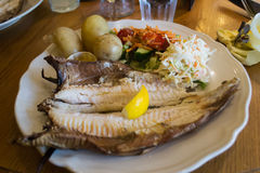 Arbroath Smokies. Arbroath Smokie (haddock) prepared with potatoes, salad, and lime. This is a typical scottish fish dish Royalty Free Stock Photos