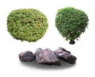 Arbustos e pedras decorativos imagem de stock