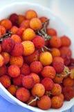 Arbutus fruits. Close up of arbutus fruits on a plate Stock Photos