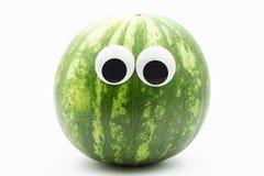 Arbuz z googly oczami na białym tle - arbuz twarz Fotografia Stock