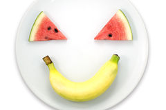 Arbuza plasterek i bananowe ono uśmiecha się twarze zdjęcie stock