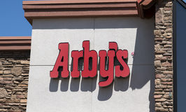 Arby's Fast Food Restaurant. International franchise chain beef sandwich food giant Arby's restaurant sign Stock Photography