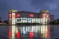 Arby's Restaurant at night. DALLAS, Tx, USA - APR 17, 2016: Arby's restaurant building illuminated at night. Arby's is the second largest sandwich chain in the U Royalty Free Stock Photos