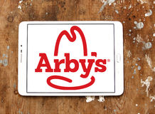 Arbys fast food logo. Logo of arbys fast food restaurants on samsung tablet on wooden background Stock Photos