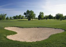 Arcón y espacio abierto del golf Fotografía de archivo