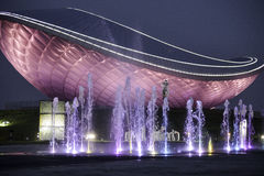 The ARC (디아크) daegu and the night illuminated fountain. The ARC (디아크) in daegu 대구 sourh korea is a modern unique curved building with colored Stock Photos