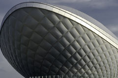 The ARC (디아크) day bkue sky and clouds. The ARC (디아크) 대구 daegu patterned structure of the curved building Royalty Free Stock Photos