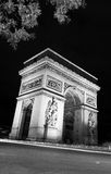Arc. Paris, Arc de Triomphe by night - Arch of Triumph - Long Exposure Royalty Free Stock Photo