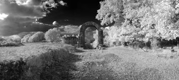 Arc of the ancient Carsulae in infrared. Panoramic view of the ancient roman ruins of Carsulae in infrared light. Stitch of images Royalty Free Stock Images