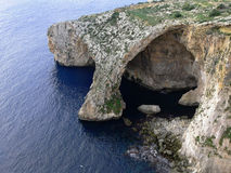 Arc Blue Grotto cavern on the south coast of Malta. Natural Arc of Blue Grotto cavern on the south coast of Malta viewed from the top of steep cliff Stock Photos
