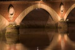 The arc of a bridge. On the river Garonne at Bordeaux by night Royalty Free Stock Images