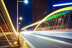 Arc bridge girder highway car light trails city night landscape. Modern city highway arc bridge night landscape of car light trails Royalty Free Stock Image