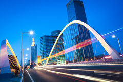 Arc bridge girder highway car light trails city night landscape Royalty Free Stock Image