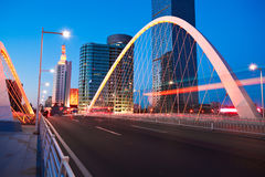 Arc bridge girder highway car light trails city night landscape Stock Photos