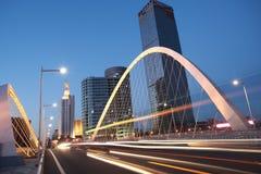 Arc bridge girder highway car light trails city night landscape Royalty Free Stock Photography