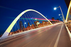 Arc bridge girder highway car light trails city night landscape Royalty Free Stock Images