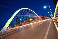 Arc bridge girder highway car light trails city night landscape Royalty Free Stock Images