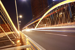 Arc bridge girder highway car light trails city night landscape. Modern city highway arc bridge night landscape of car light trails Stock Photos