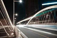 Arc bridge girder highway car light trails city night landscape. Modern city road arc ironbridge night landscape of car light trails in Tianjing Royalty Free Stock Image