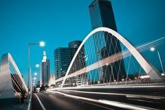 Arc bridge girder highway car light trails city night landscape. Modern city road arc ironbridge night landscape of car light trails in Tianjing Stock Photo