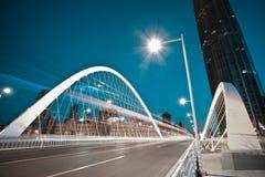 Arc bridge girder highway car light trails city night landscape. Modern city road arc ironbridge night landscape of car light trails in Tianjing Stock Images