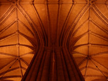 Arc ceiling with a column. Of a building used to be church but now restored to be an educational venue Stock Photography