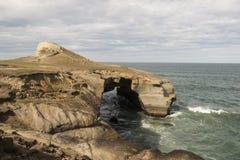 Arc cliff cave on the coast New Zealand. Arc cliff cave on the coast of the South Island of New Zealand Stock Photography