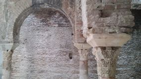 Arc and columns in arab bath. Detail of a column in the ancient arab bath or hammam `El Bañuelo` in Granada, Andalusia, south of Spain Stock Photos
