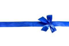 Arc de ruban bleu sur le fond blanc Photo libre de droits