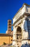 Arc de Titus and Basilica di Santa Francesca Romana in Rome. Italy Stock Photography