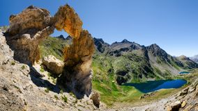 Mercantour Park, Arc de Tortisse and Lacs de Vens. The Arc de Tortisse, famous natural limestone arch in the national park of Mercantour France with the upper Royalty Free Stock Photography