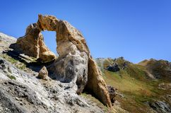 Arc de Tortisse France. The Arc de Tortisse, famous natural limestone arch in the national park of Mercantour near the lake of Vens France Royalty Free Stock Photo