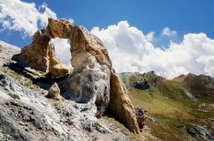 Arc de Tortisse France. The Arc de Tortisse, famous natural limestone arch in the national park of Mercantour near the lake of Vens France Stock Photography