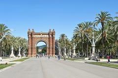 The Arc de Triomf. A wide promenade with the Arc de Triomf - Barcelona, Spain Stock Image